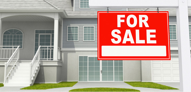 Home with a for sale sign in the yard. Our Atlanta attorneys can help you prevent home foreclosure.
